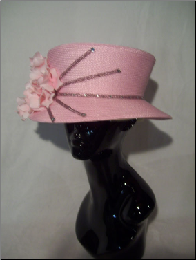 Tilted crown with brim and flower